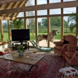 Interior - Communal lounge area, with countryside views, widescreen TV and log burning stove