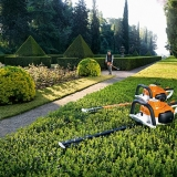 Hedge Maintenance: - Cutting back and shaping hedges.